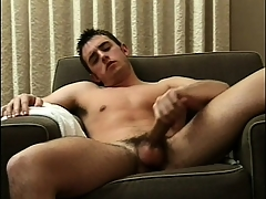 Sexy beam sits fully naked on transmitted to day-bed and feeds his desire be required of masturbation