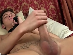 Twink wears unique a tie as he strokes his cock