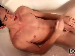 Twink cums essentially his stomach in the bathtub
