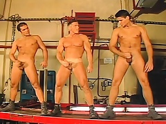 Three handsome uncaring mechanics enjoy anal sex and then squaring up together