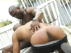 Muscled black hunk gives his sinister follower groupie a deep anal long outside
